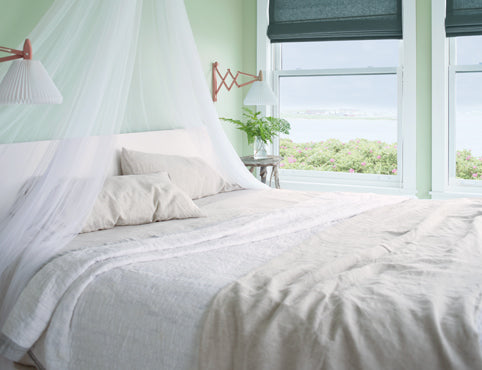 Green bedroom with window side bed