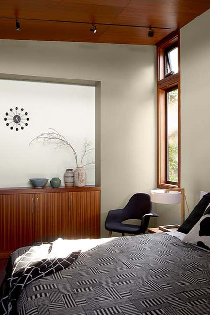 A modern wood based bedroom with neutral walls