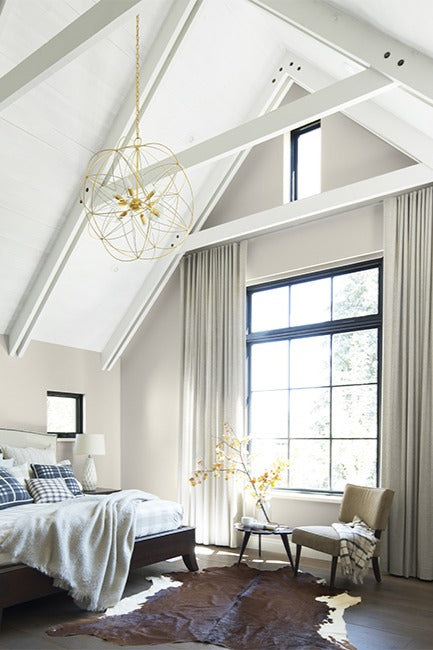 Top floor bedroom with high white ceilings and neutral color palettes
