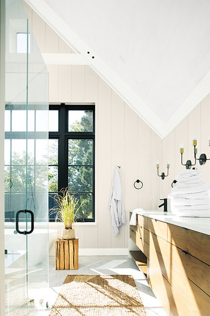 A light and airy bathroom painted in neutral and white paint colors