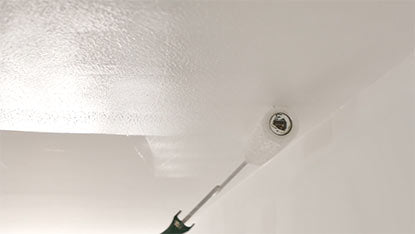 How to paint a ceiling with a roller
