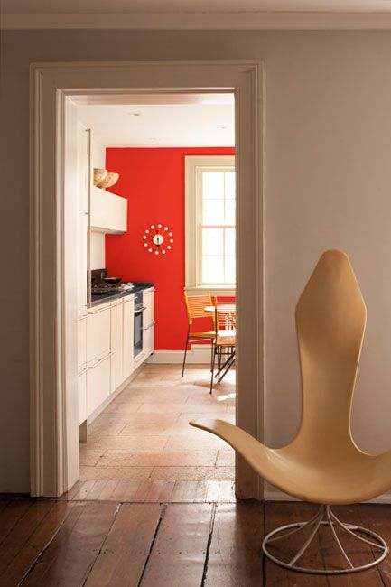 Tomato Tango Red paint color on kitchen accent wall