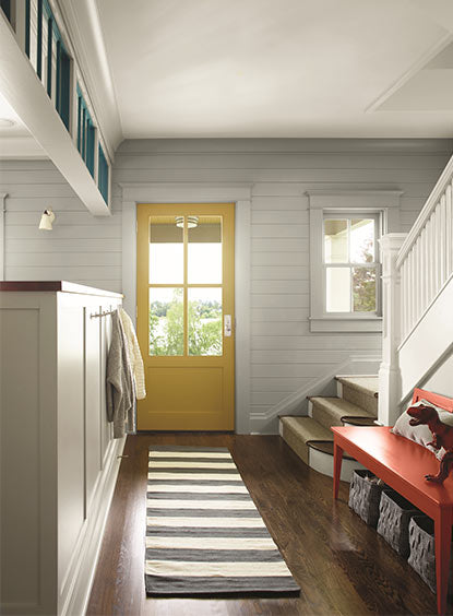 Entryway with yellow painted door and high-gloss finish