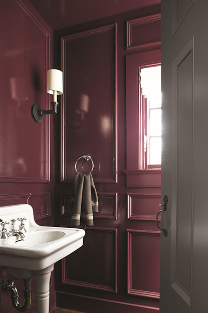 Bathroom walls painted in deep purple paint color in high gloss finish.