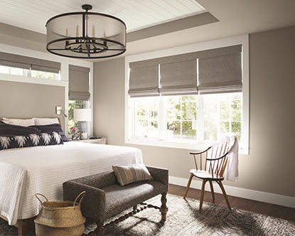 Bedroom painted in greige paint color with matte finish