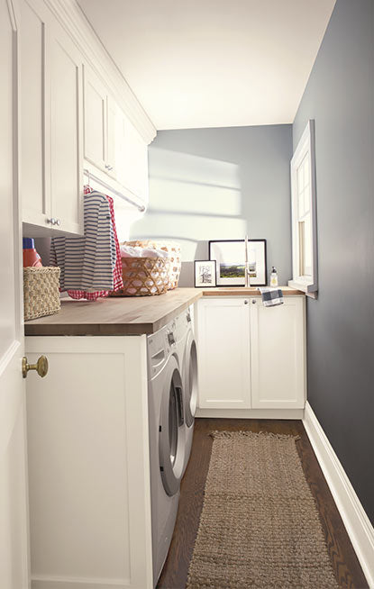 Laundry room walls painted in blue gray paint color with pearl finish