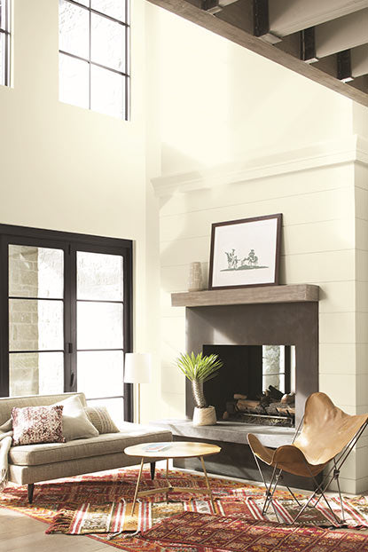 Living room walls in off-white paint in satin finish.
