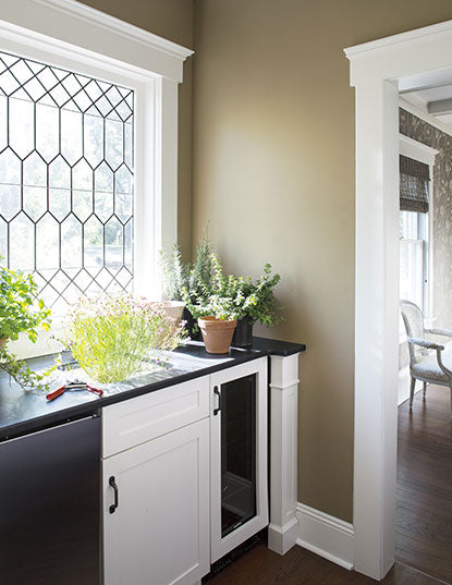 A corner pantry with Hancock Gray HC-97 walls and White Dove OC-17 cabinets.