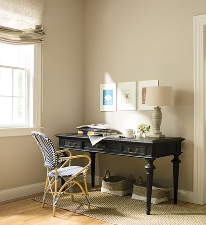 A corner study area with walls painted in Shaker Beige HC-45 and ceilings painted in Simply White OC-117.