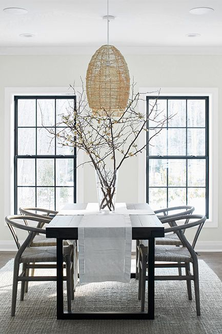 A modern dining area with Paper White OC-55 walls and ceilings painted with Distant Gray OC-68.