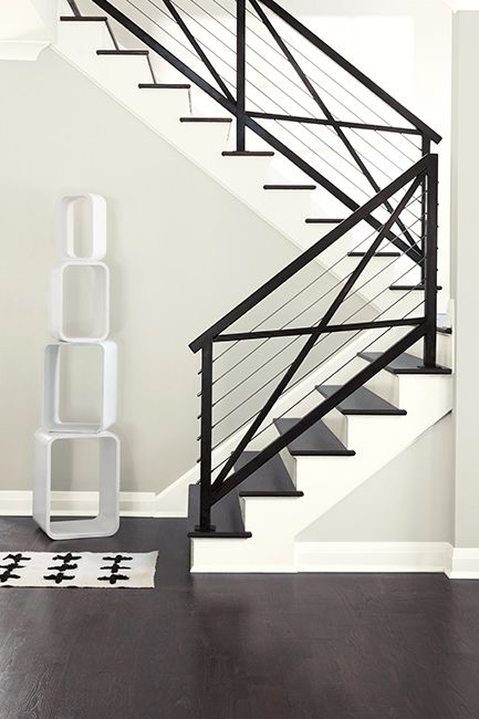 Modern staircase framed by white walls painted with Paper White OC-55.