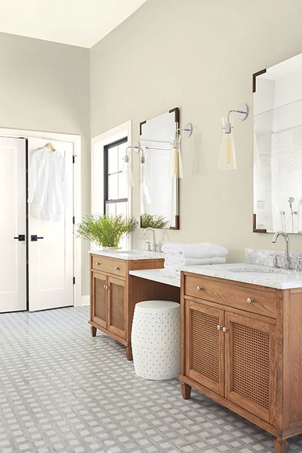 Sunny, white bathroom with matching wooden vanities and white walls painted with Ballet White OC-9.