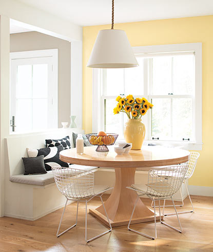 A sunny kitchen corner painted in Hawthorne Yellow HC-4.