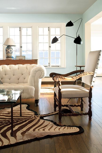 White living room with hardwood floors and mixed style