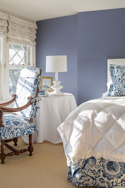Master bedroom with accent lavender wall
