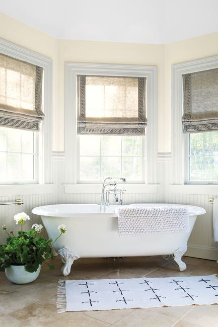 Bathroom walls painted in a matte light yellow mayonnaise paint color