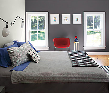 Modern gray bedroom with walls painted in Arctic Seal CSP-15 and Perspective CSP-5.