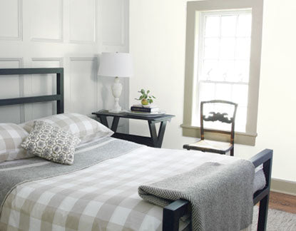 Paneled bedroom with coordinating gray tones