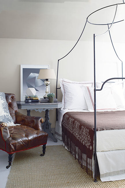 Industrial style canopy bed and neutral bedroom