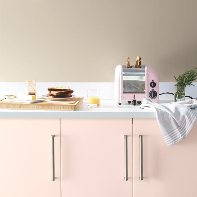 A pale kitchen with pink cabinets painted with Benjamin Moore's 2020 Color of the Year, First Light 2102-70