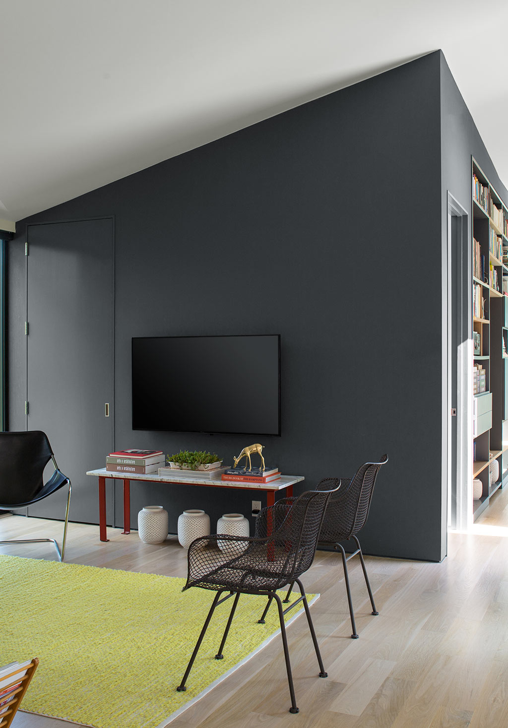 Contemporary living room with dark gray feature wall.