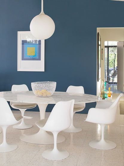 Bold, blue contemporary dining area with tiled floors