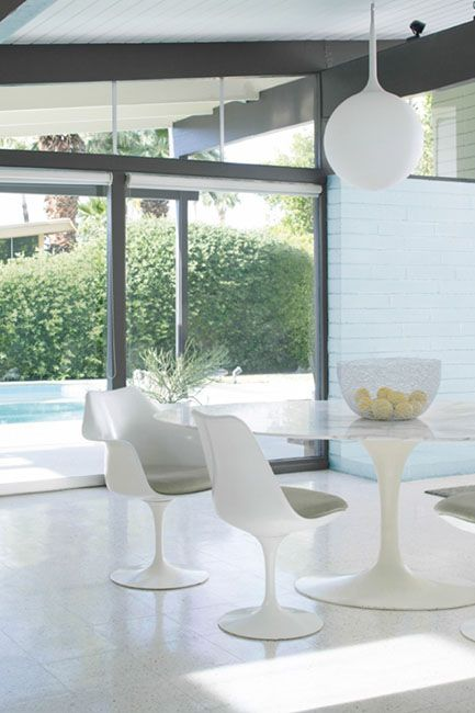 Mid-century dining room with poolside view