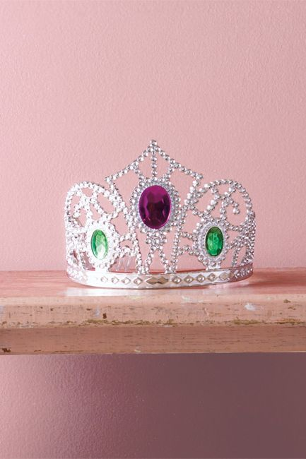A pink-hued wall sets off a bejewelled tiara.