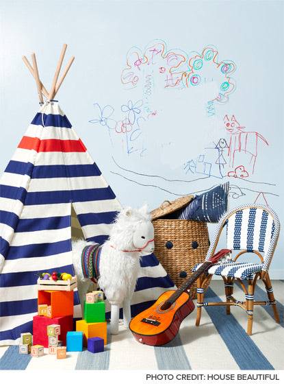 A light blue chalkboard wall makes a fun accent in a kid's bedroom.