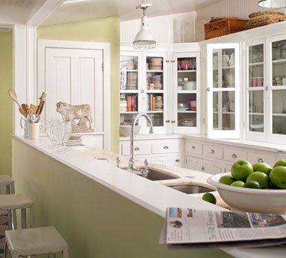 Fresh green kitchen walls with breakfast bar seating