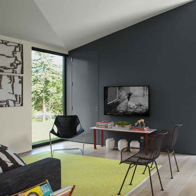 Gray painted accent wall with white walls in living room