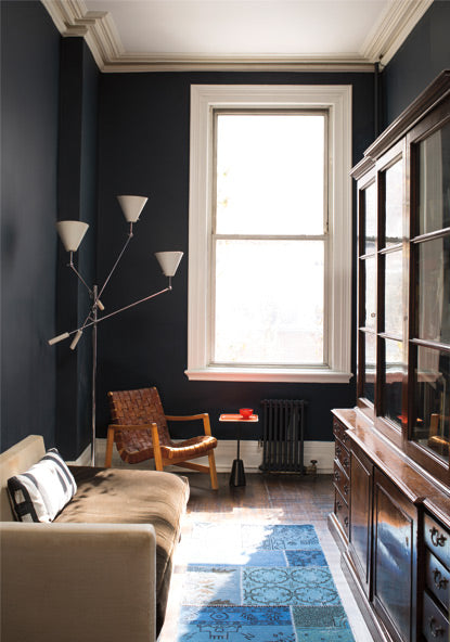 Deep blue painted walls in living room