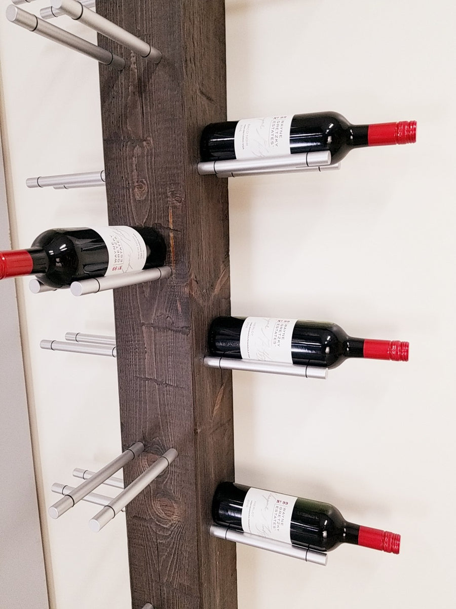 Wall hung timber wine tree with aluminum wine pegs.