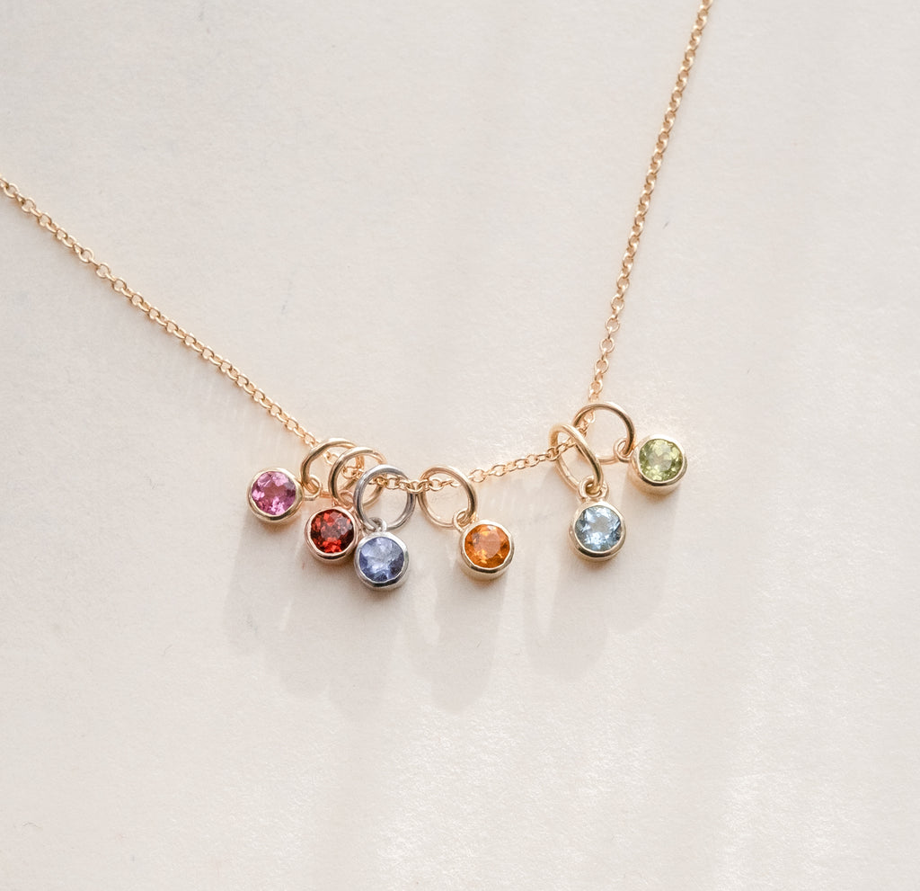 birthstone charms stacked on a necklace