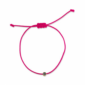 black diamond, yellow gold, pink cord