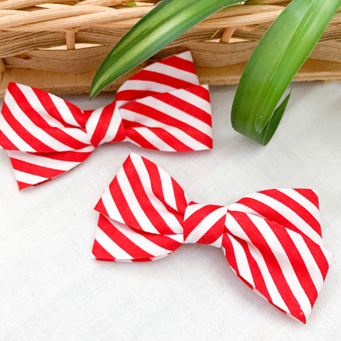 Red and white striped pigtail bows for babies and toddlers