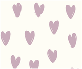 A close up of the light purple heart patter on 100% organic cotton fabric
