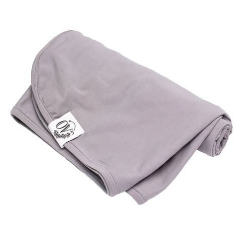 A gender neutral plain grey swaddle blanket for babies. Ethically handmade in Canada from the OVer Company
