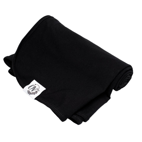 A plain black swaddle blanket. Handmade in Canada from the OVer Company