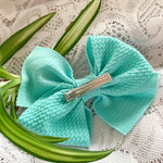 Bow available as both a headband with soft nylon or as an alligator clip