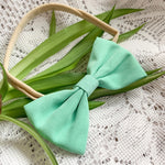 Handmade baby bow in teal with vintage feel locally made