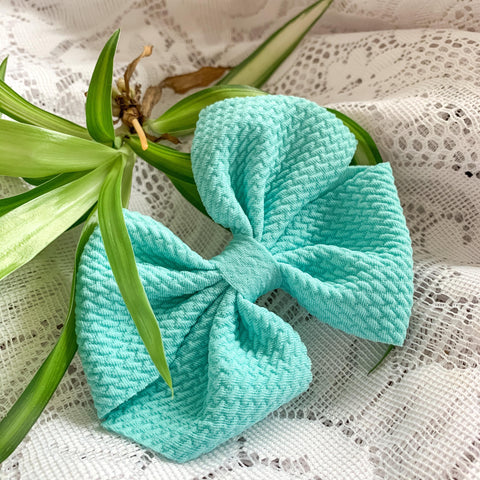 A large teal bow for babies and toddlers. Ethically and locally made in Kitchener, Ontario