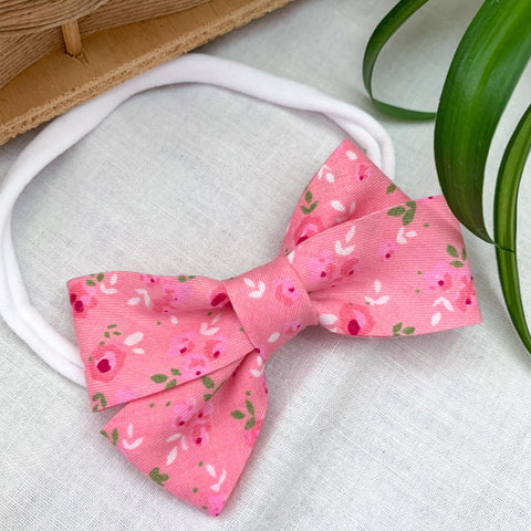 A pink flower bow for babies, toddlers, and infants. Locally handmade