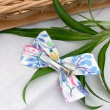 Alligator clip on the locally handmade floral baby bow