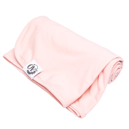 A solid pink swaddle blanket from the OVer Company
