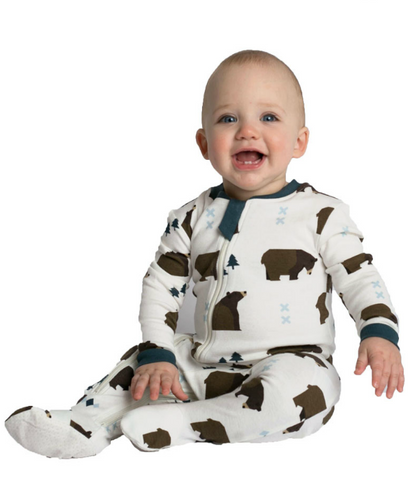 Baby wearing white organic cotton zippyjamz with a grizzly bear print