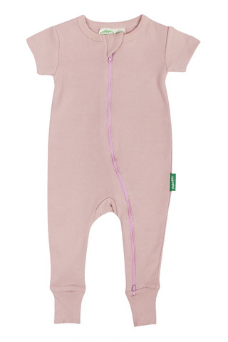 a pink short-sleeve romper with a double zipper for easy changing. Made fair trade with 100% organic cotton