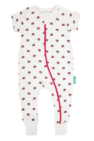 A light cream 100% organic cotton romper with a red double zipper for easy changing. Short sleeves.