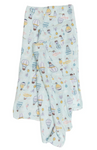 A light blue eco-friendly swaddle blanket with light yellow and darker blue hot air balloons on it