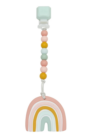 A rainbow teething toy with pink, orange, and blue tones. Featuring a detachable silicone beaded clip.